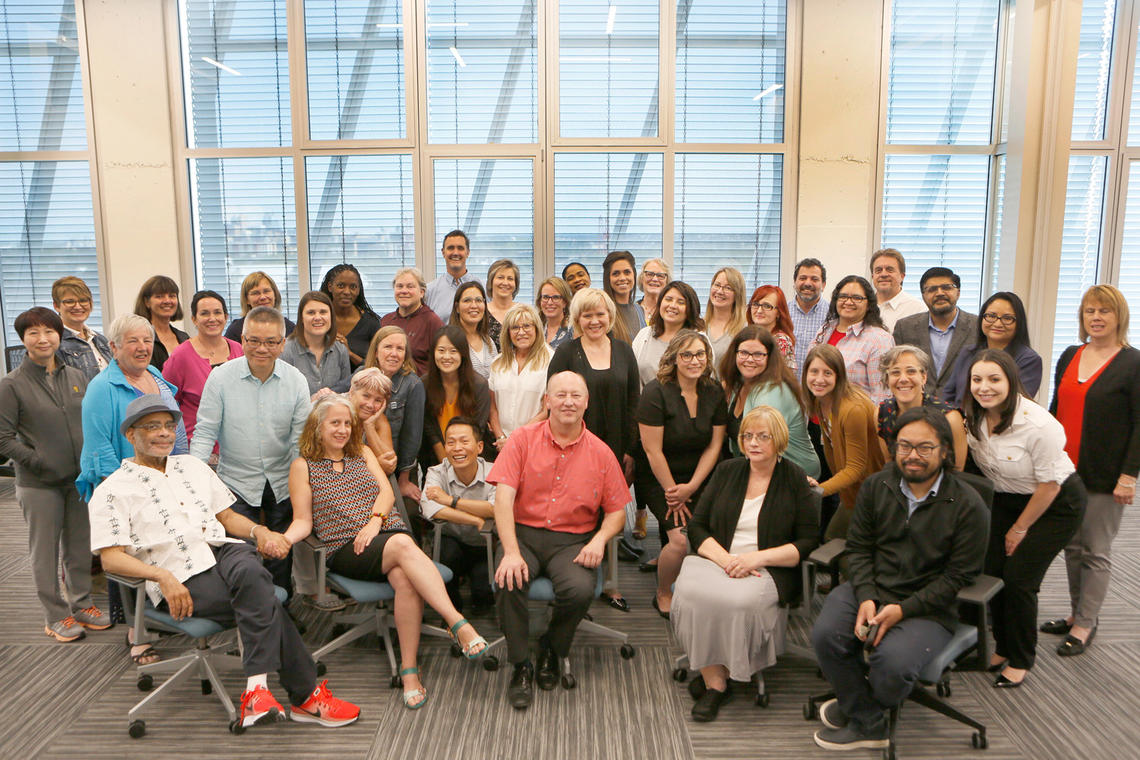 A group photo of UCalgary Faculty of Social Work faculty and staff, taken in August of 2019