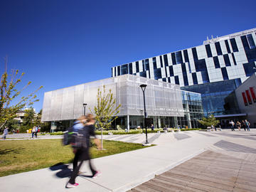 Students walking toward the state-of-the-art Taylor Family Digital Library at the University of Calgary - Faculty of Social Work