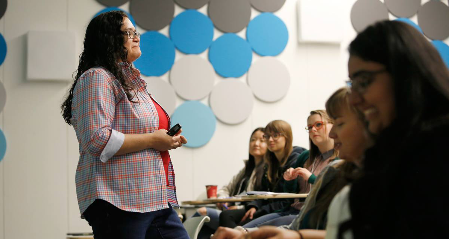 University of Calgary Faculty of Social Work professor addresses students at an orientation meeting